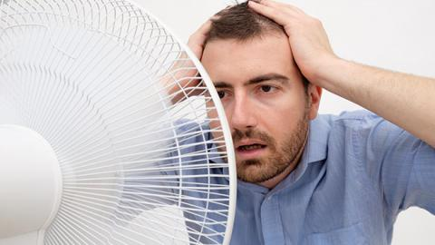 Man in front of a fan